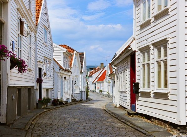 Street with white wooden houses in old centre of Stavanger