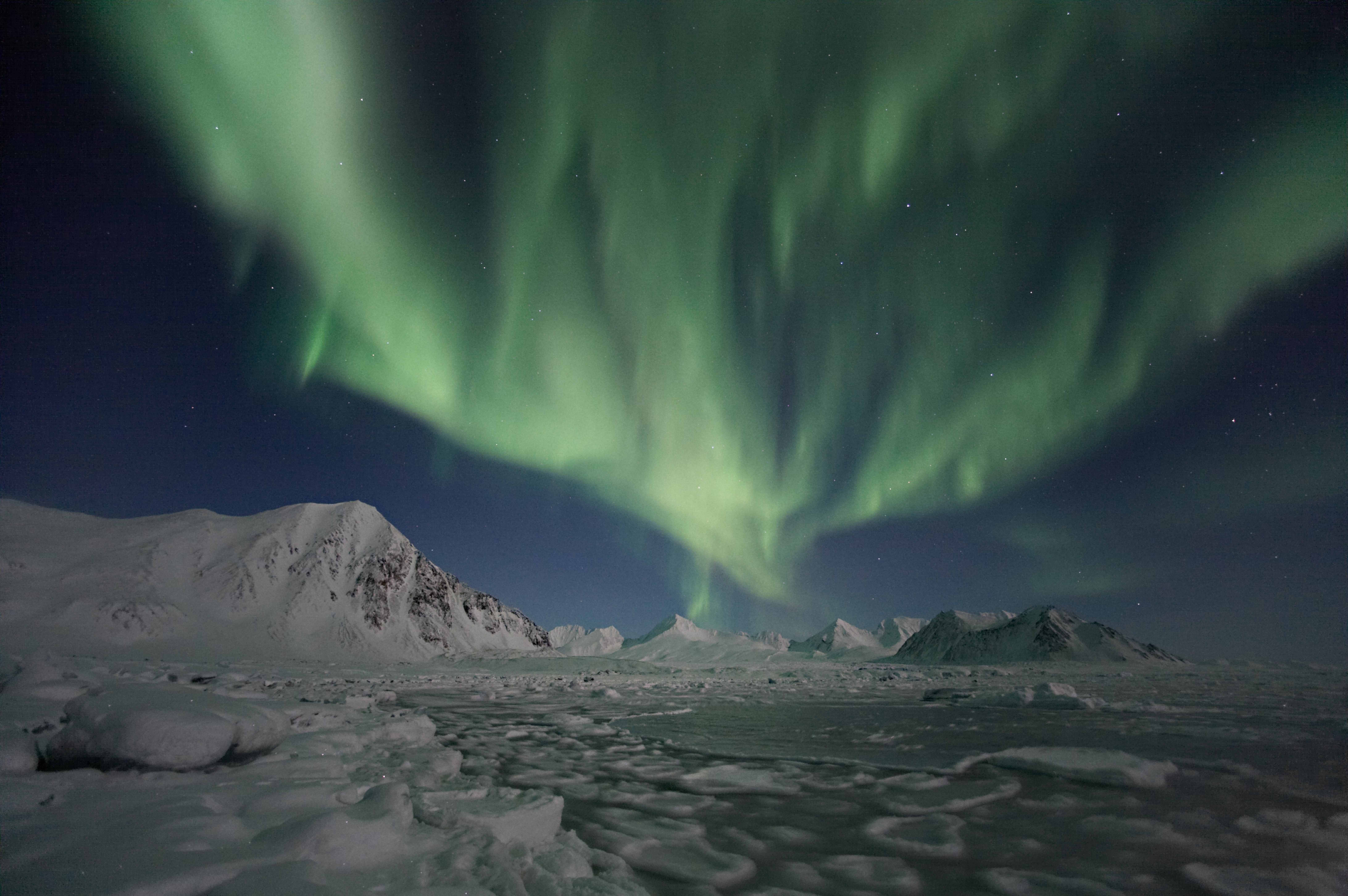 Northern Lights above the Svalbard mountains